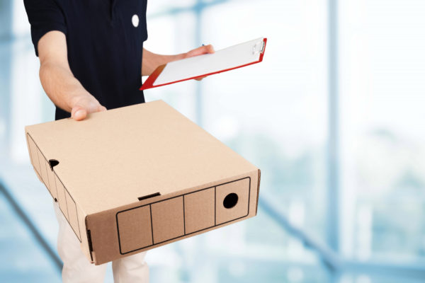 Courier Handing Packing Out to Customer - Mailing Methods